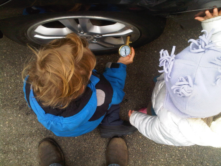 CC image Kids checking the tire pressure by notpierre on Flickr
